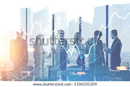 Business people silhouettes in a modern office. Graphs and a morning cityscape background. Toned image double exposure #1106505209