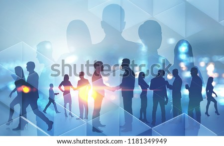 Business people silhouettes walking, talking and shaking hands over night city background. Partnership and sealing a deal concept. Toned image double exposure copy space #1181349949