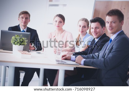 Business people sitting and discussing at business meeting #716098927