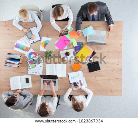 Business people sitting and discussing at business meeting, in office #1023867934
