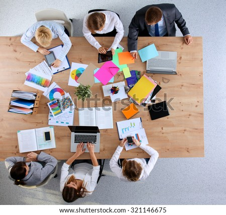 Business people sitting and discussing at business meeting, in office #321146675