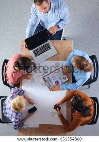 Business people sitting and discussing at business meeting, in office #351354860