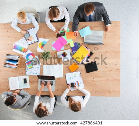 Business people sitting and discussing at business meeting, in office #427886401