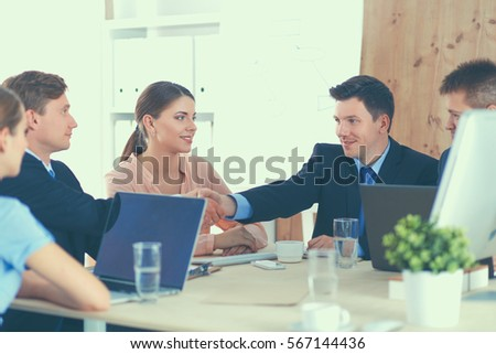 Business people sitting and discussing at meeting, in office #567144436