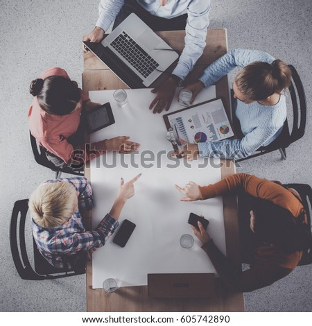 Business people sitting and discussing at meeting, in office - Shutterstock ID 605742890