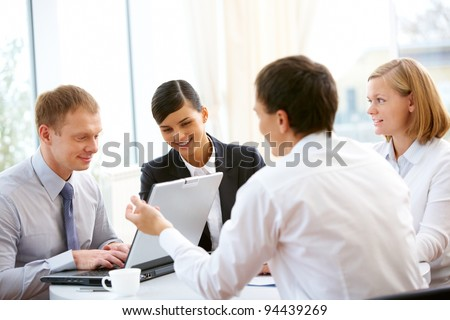 Business people sitting around the table and working together