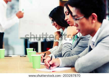 Business people sitting at the meeting in office