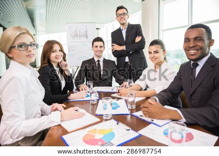 Business people sitting in conference room and working.