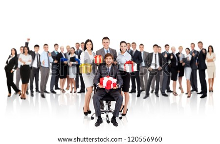 Business people smile group team hold gift box presents, sitting in chair, with big group crowd of businesspeople on background concept of corporate holiday