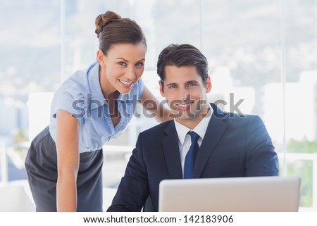 Business people smiling together in the office