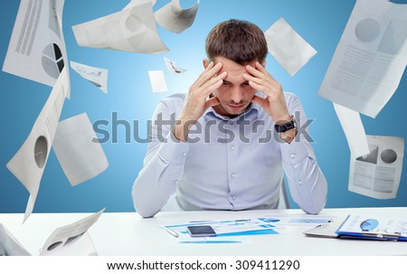 business, people, stress, deadline and technology concept - close up of businessman with smartphone and papers over blue background