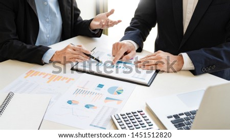 Business People Talking Discussing with coworker planning analyzing financial document data charts and graphs in Meeting and  successful teamwork Concept #1451512820