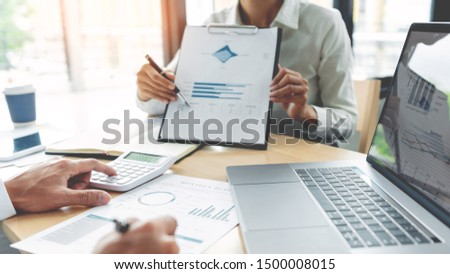Business People Talking Discussing with coworker planning financial document data charts and graph and idea with colleague in office. #1500008015