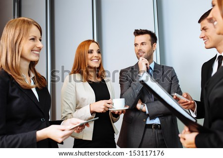 Business people talking during conference break; networking #153117176