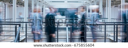 Business people talking in office corridor, industrial interior, panorama