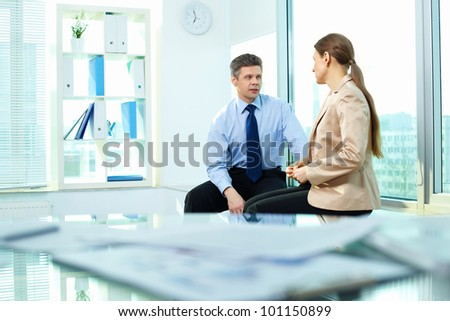Business people talking in the middle of the workday