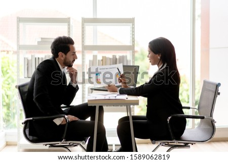 Business People Talking Together Discussing Plan Profit of Project while Colleague Conversation at Office.