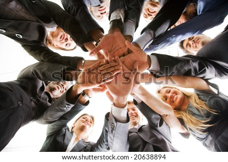 business people teamwork in an office with hands together - isolated - stock photo