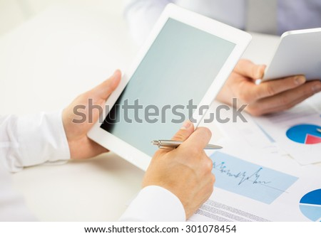 business, people, technology, advertisement and teamwork concept - close up of businessman hands with tablet pc computer blank screen at office