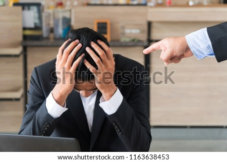 Business people the boss, point fingers, blame. Young businessmen holding the head stress being boss blame.  Concept of accused businessman with fingers pointing. Stockfoto ©