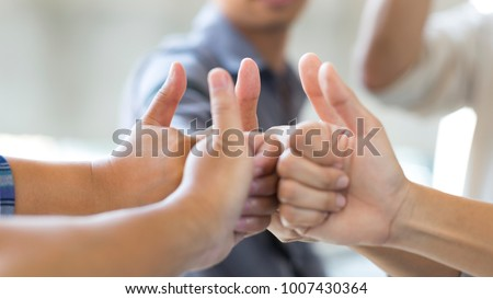 Business people thumb up , team success symbol. Soft focused with beautiful blurred background. #1007430364