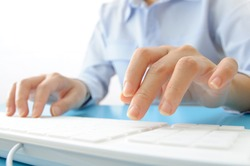 Business people typing on computer keyboard