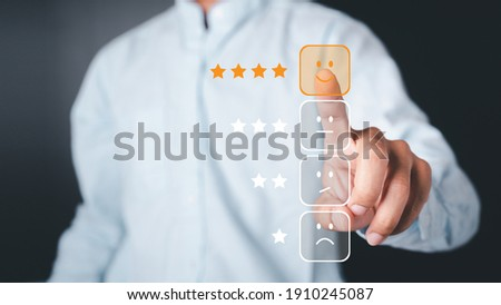Business people use the index finger to touch the virtual screen to select the starred icons, future digital technology working in digital form, business strategy concepts, human business concepts. Foto stock ©