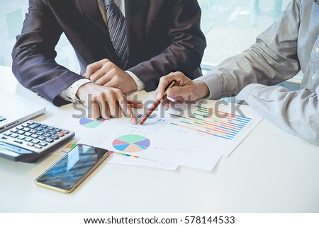 Business people using computer meeting to analyze and discuss the situation on the marketing data online in the meeting room.Business concept idea background. #578144533