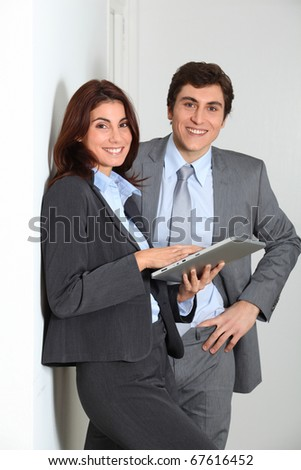 Business people using electronic tab
