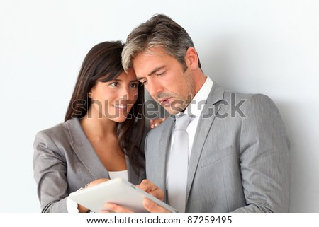 Business people using electronic tablet