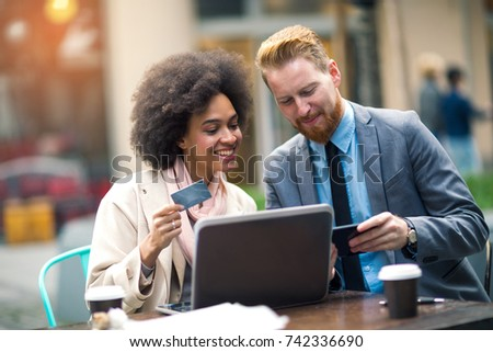 Business people using laptop to on line shopping. Business and coworker concept