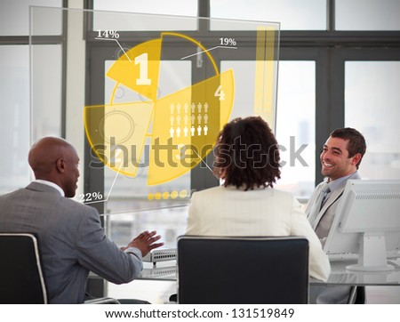 Business people using yellow pie chart interface in a meeting