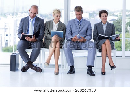 Business people waiting to be called into interview at the office