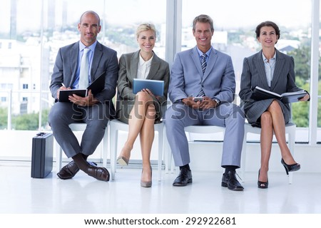 Business people waiting to be called into interview in the office