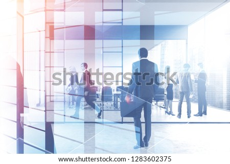 Business people walking and discussing work in modern office with conference room with double exposure of skyscraper. Toned image #1283602375
