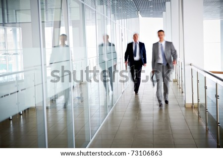 business people walking in the...