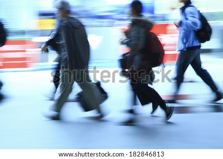 business people walking in train station in taiwan