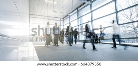 Business People Walking on a modern walkway #604879550