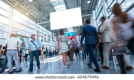 Business People Walking on trade fair