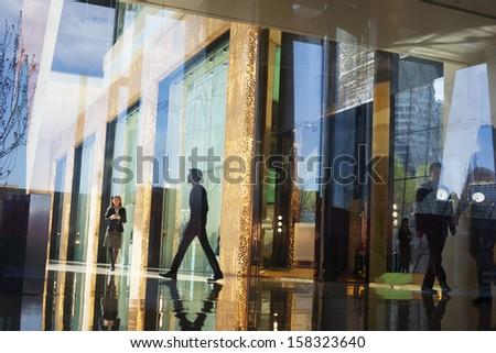 business people walking through ...