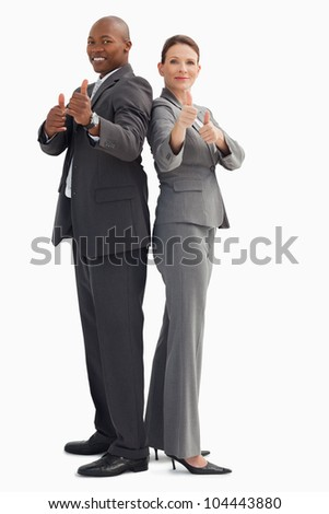 Business people who have their thumbs up