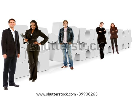 Business people with a puzzle isolated on white - stock photo