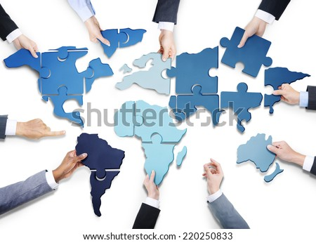 Business People with Jigsaw Puzzle Forming World Map