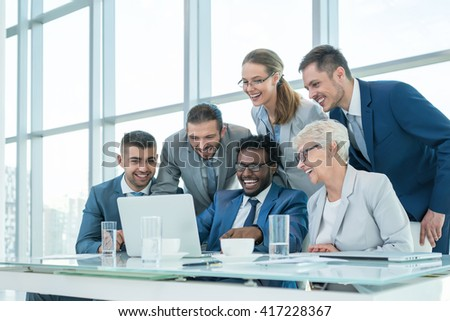 Business people with laptop in office #417228367