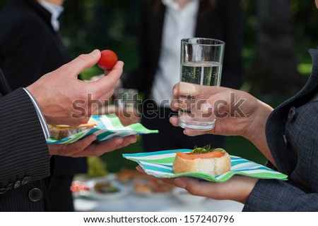 Business people with snacks discussing during lunch