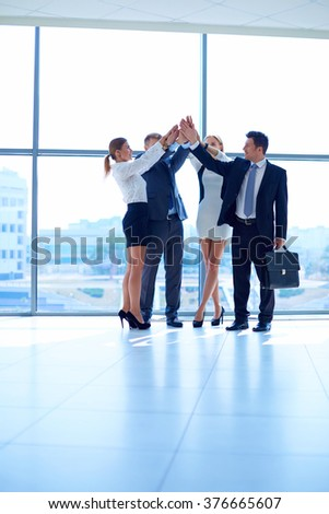 Business people with their hands together in a circle #376665607