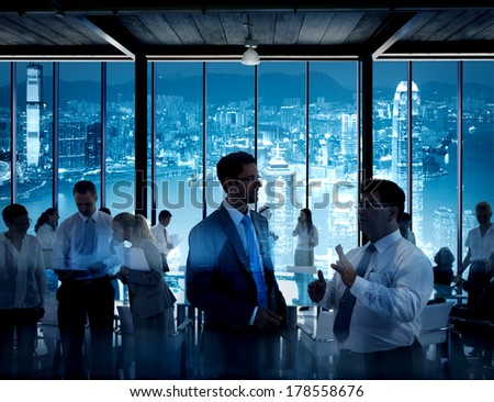 Business People Working in a Conference Room with City Skyline
