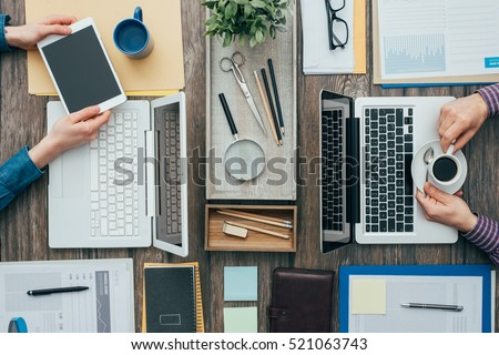 Business people working in the office, they are using a laptop and a digital tablet, flat lay