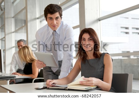 Business people working in the office with agenda - stock photo