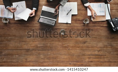 Business people working on a wooden table website banner template
